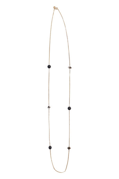 Long necklace with decorative charms